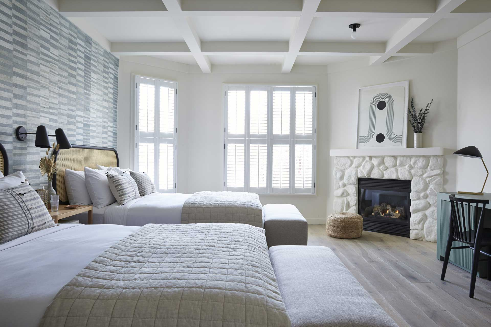 two queen beds with fireplace and desk